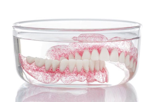 Could Your Denture Cleaner Be Poisoning You?